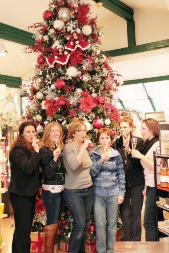 alena kirby staff celebrating after christmas setup