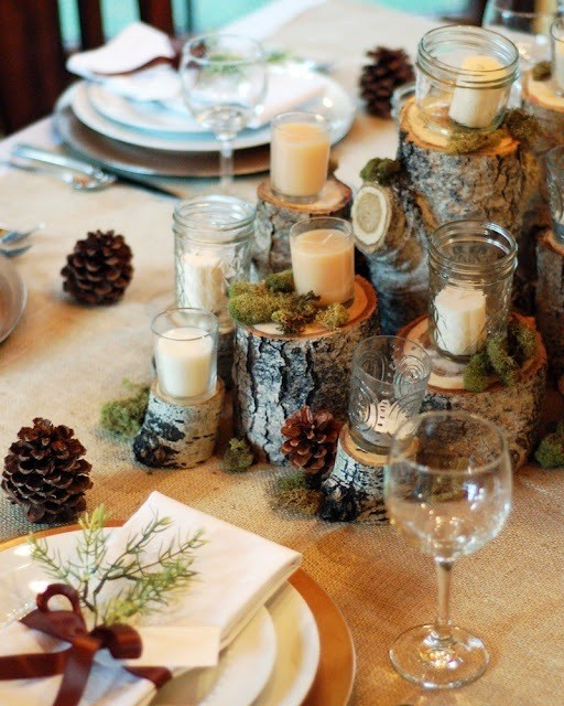 Fall table setting with pinecones, birch wood and moss