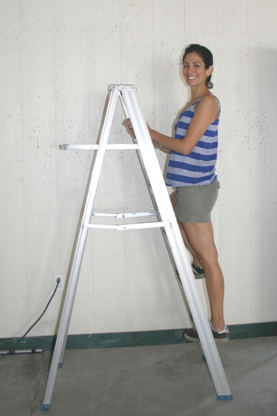 Stefanie, sanding the walls,  loves a good DIY project.