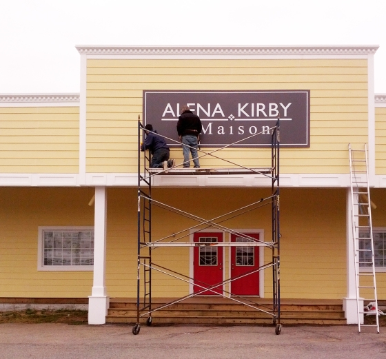 Putting up the new sign!