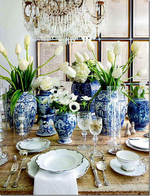 blue-white-ginger-jars-framed-prints-wall-decor-gilded-chandelier-dining-room-decorating-ideas-veranda